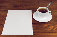 White paper on a wooden table Royalty Free Stock Image