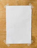 White paper on the wooden wall Royalty Free Stock Images
