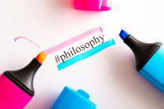 On a white paper written tag philosophy circled in different color markers in red and blue. Philosophy and color royalty free stock photo