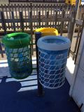 Three urban waste bins for the separate collection of waste. White for paper, yellow for aluminum, green for unsorted waste stock photography