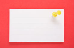 White Paper and Yellow Push Pin on red background(with clipping Stock Photos