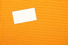 White paper on the yellow sand Stock Image