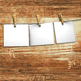 White papers attach to rope with clothes pins Royalty Free Stock Images