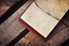 White papers in a copybook on the wooden desk Royalty Free Stock Photos