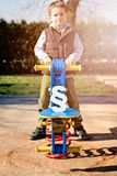 White paragraph symbol and child on children playground Royalty Free Stock Photos