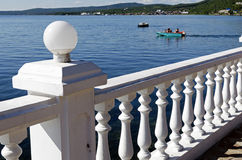 White parapet, the Angara River, motorboat Royalty Free Stock Photo