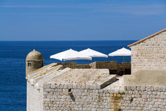 White Parasols over a Blue Sea Royalty Free Stock Photography