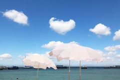 The white parasols on the sea breeze Royalty Free Stock Images