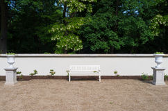 White park bench. This park bench is located in Warsaw Łazienki, Poland Royalty Free Stock Image
