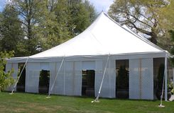 White party tent. Large event Party tent in a garden setting Stock Photos