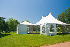 White party or event tent on lawn. Large white party tent set up on a front lawn for a wedding or special event Stock Images