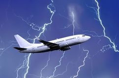 White passenger airplane takes off during a thunderstorm night lightning strike of rain, bad weather. White passenger airplane takes off during a thunderstorm Royalty Free Stock Image