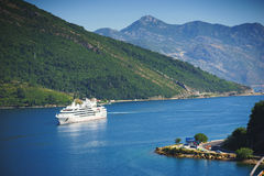 White passenger liner in the bay. Montenegro, Boka Kotorska bay on a hot summer day. Royalty Free Stock Photography