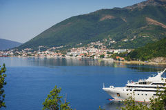 White passenger liner in the bay. Montenegro, Boka Kotorska bay on a hot summer day. Stock Images
