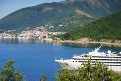 White passenger liner in the bay. Montenegro, Boka Kotorska bay on a hot summer day. Stock Photography
