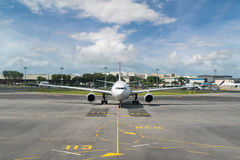 White passenger plane takes off from the airport runway. Airplan Stock Image