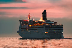 White cruise liner. White passenger ship sailing in evening in still water Royalty Free Stock Photos