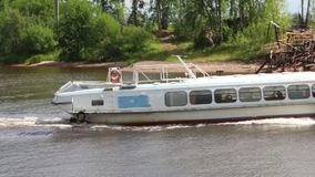 White passenger ship sails on river at sunny summer day stock video
