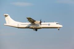 White passenger turboprop aircraft Stock Photo