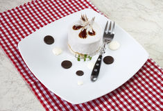 White pastry with fork Stock Images