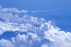 White Path Leading Through Clouds to Heaven. Whate pathway leading up through the clouds in the sky perhaps to heaven Royalty Free Stock Photo