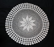 White pattern crochet tablecloth. Pattern of white  crochet tablecloth Royalty Free Stock Photography