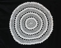 White pattern crochet tablecloth. Pattern of white  crochet tablecloth Stock Photos