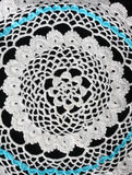 White pattern crochet tablecloth. Pattern of white and blue crochet tablecloth Stock Photo