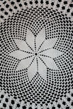 White pattern crochet tablecloth. Pattern of white  crochet tablecloth Royalty Free Stock Photo