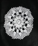 White pattern crochet tablecloth. Pattern of white  crochet tablecloth Stock Images