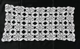 White pattern crochet tablecloth. Pattern of white  crochet tablecloth Stock Photo
