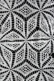 White pattern crochet tablecloth Royalty Free Stock Images