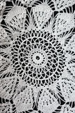 White pattern crochet tablecloth. Pattern of white  crochet tablecloth Royalty Free Stock Image