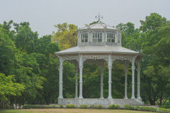 White pavilion in European style with green trees background. Royalty Free Stock Image