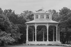 White pavilion in European style surrounded with green trees at public park. Royalty Free Stock Photography