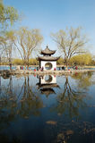 White pavilion and its reflections in lake Stock Photo