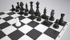 White pawn before the army of black chess pieces Stock Image