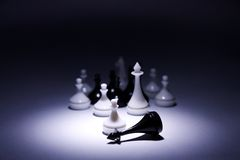 White pawn with army defeats black king Stock Image