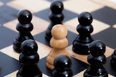 White pawn and black ones Stock Photos