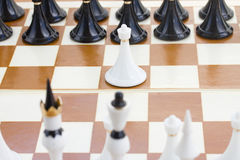 White pawn in front of black chess Royalty Free Stock Images