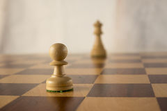 White  pawn and white queen Royalty Free Stock Image