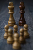 White Pawns Against Kings Royalty Free Stock Photography
