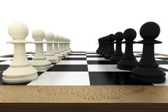 White and pawns facing off on board Royalty Free Stock Images
