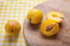 White Peach. Organic fruit on wood Chopping Board background royalty free stock photo