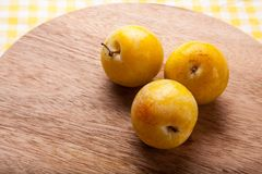 White Peach. Organic fruit on wood Chopping Board background royalty free stock image