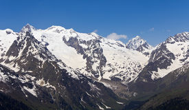 White peaks mountains of Dombai. Royalty Free Stock Photos