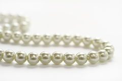 White Pearl. Women's jewelry white pearl on a white background Royalty Free Stock Photo