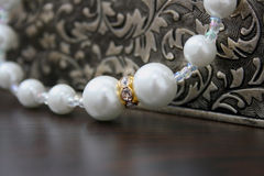 White pearl. Gift box and white pearl Royalty Free Stock Image