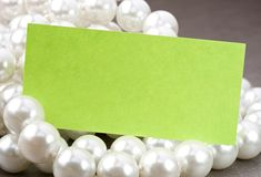 White pearl. And blank card Royalty Free Stock Photo