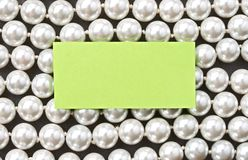 White pearl and card Royalty Free Stock Photo